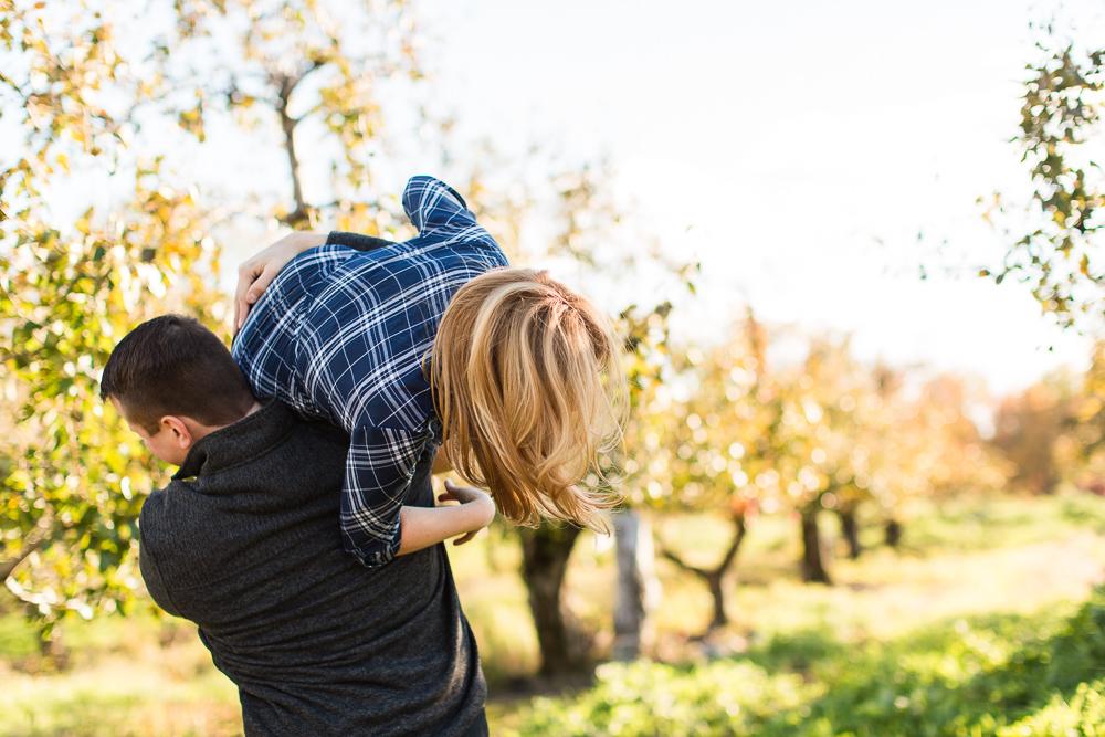 Funny engagement picture carrying his fiance over his shoulder | Fun Engagement Photographer in Hudson Valley, NY