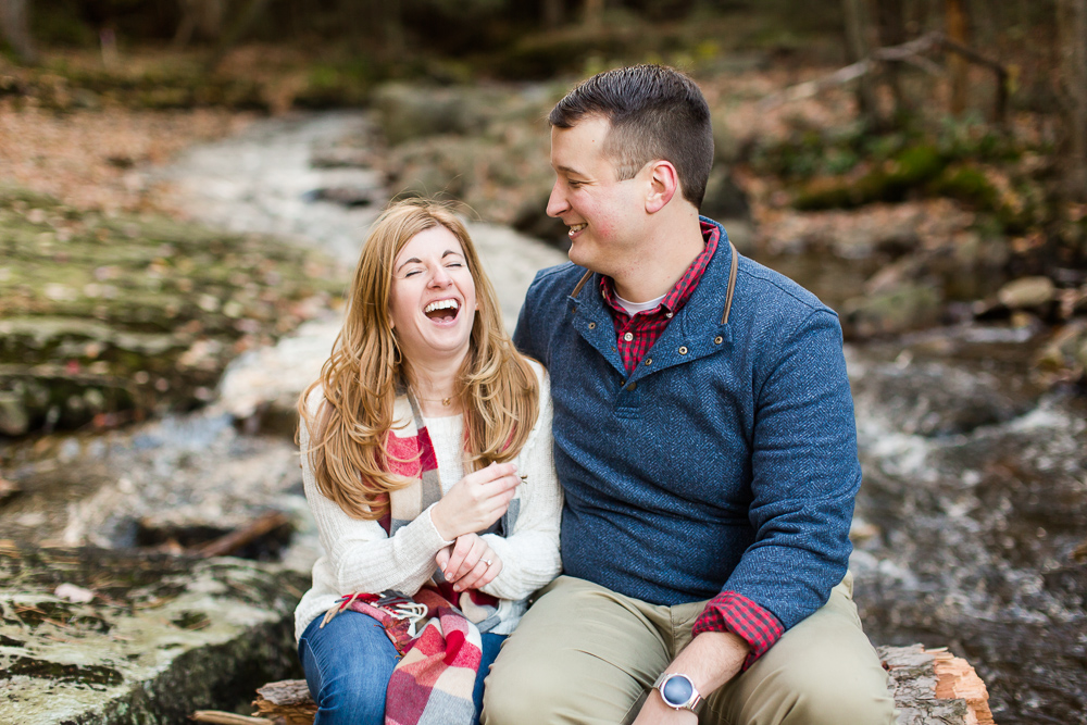 Candid engagement photo in the creek at Minnewaska State Park | Adventure engagement photography in Hudson Valley, NY