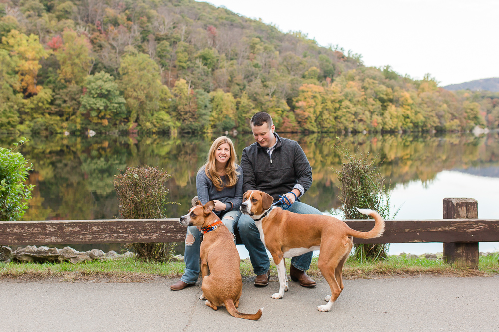 Engaged couple with their rescue dogs at Hessian Lake in Bear Mountain State Park, NY