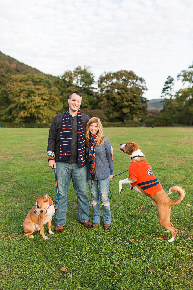 Auburn University fans and their dogs, all wearing Auburn gear for engagement photos