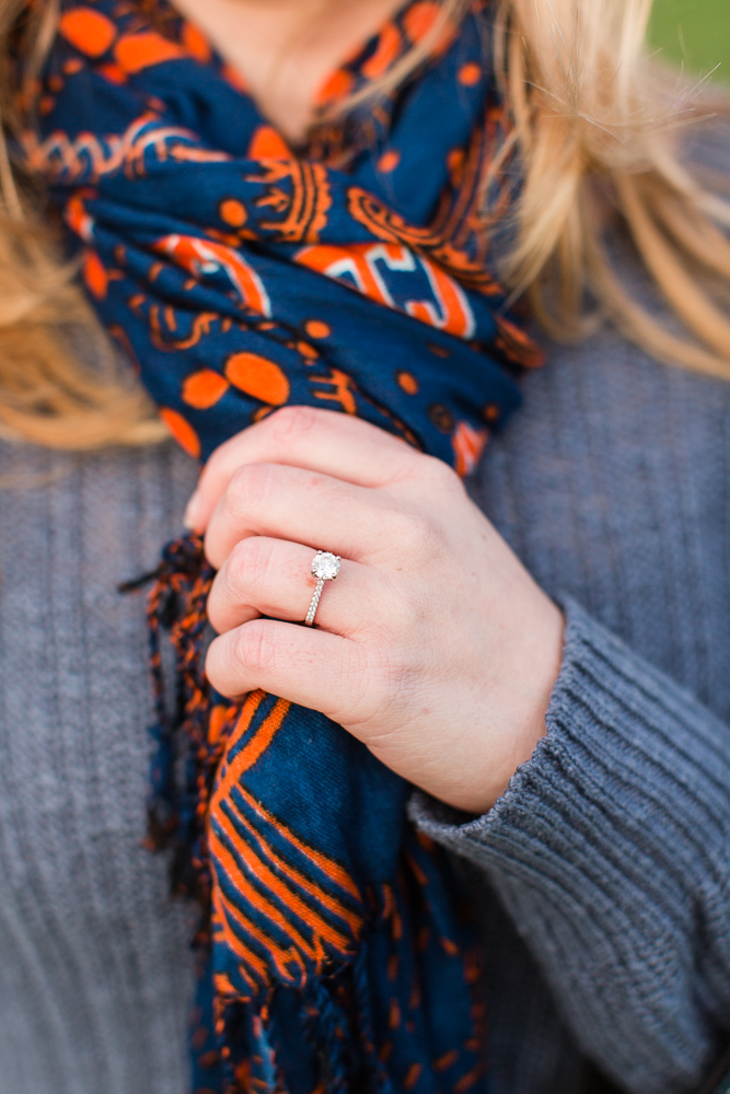 Close up photo of engagement ring with Auburn University scarf | Auburn engagement pictures
