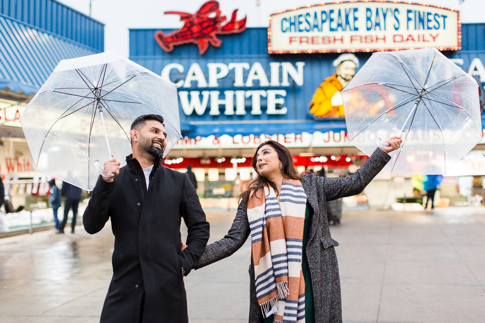 Dancing in the rain at the DC Wharf fish market | Fun DC engagement pictures