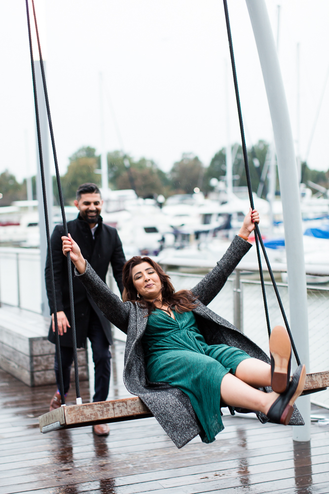 Having fun on the giant swings on the pier at Wharf DC | Fun engagement locations in Washington, DC