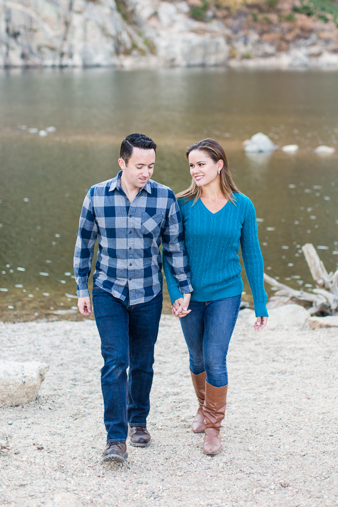 Candid picture of couple walking along the lake at St. Mary's Glacier | Best spots in Colorado for engagement pictures