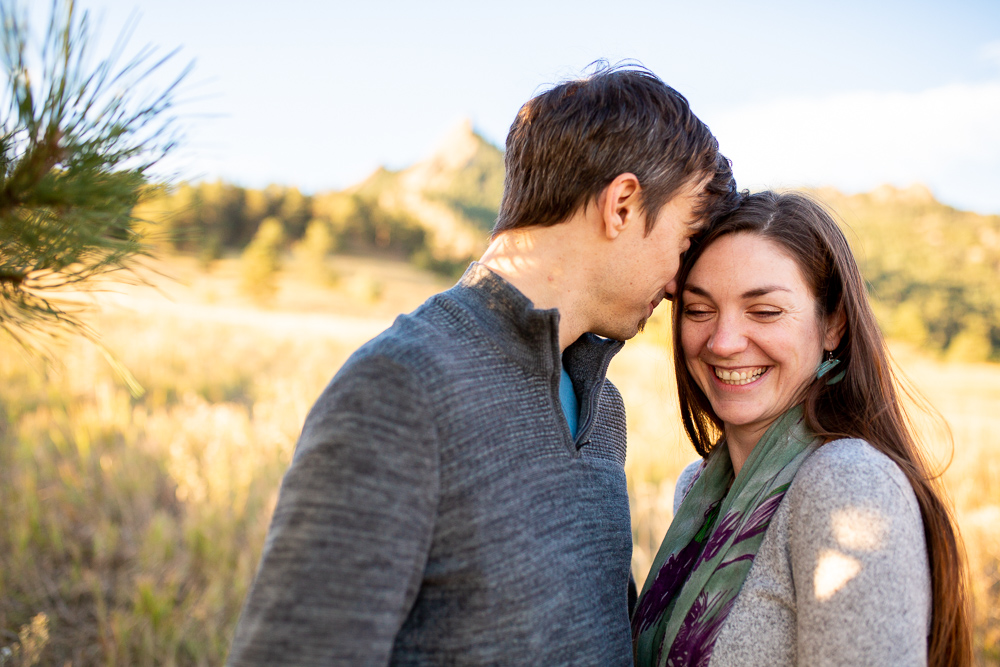 Happy couple cuddling during their photo shoot in Boulder, Colorado