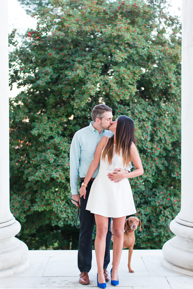 Engagement picture between the white columns of the Jefferson Memorial | Best Places in DC for Engagement Photos