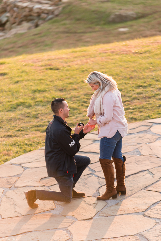 Getting down on one knee to propose to his girl friend at Stone Tower Winery | Northern Virginia Engagement Locations
