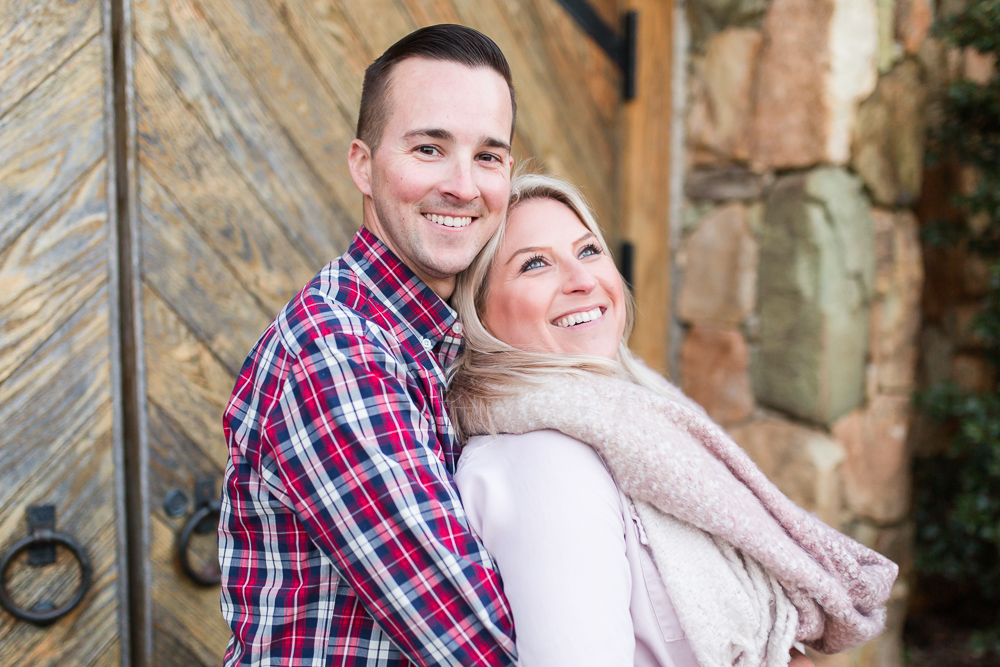 Engaged couple smiling in front of the grotto at Stone Tower Winery | Stone Tower Winery Photographer