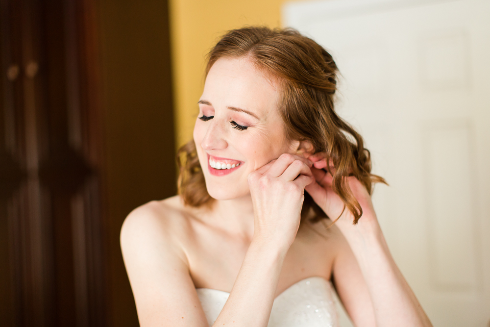 Candid wedding photo of bride putting in her earrings | Northern Virginia Wedding Photography