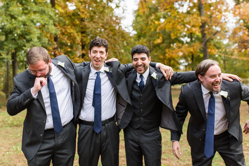 Fun group of groomsmen at a fall wedding in Loudoun County