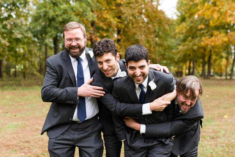 Fun group of groomsmen giving the groom a giant hug | Leesburg Virginia Wedding