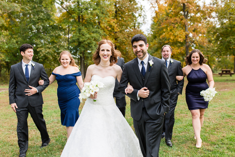 Wedding couple with the bridal party on their fall wedding day at the Harvest House at Lost Creek Winery | Loudoun County Wedding