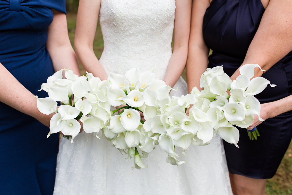 Bouquets of white cala lilies during a fall wedding