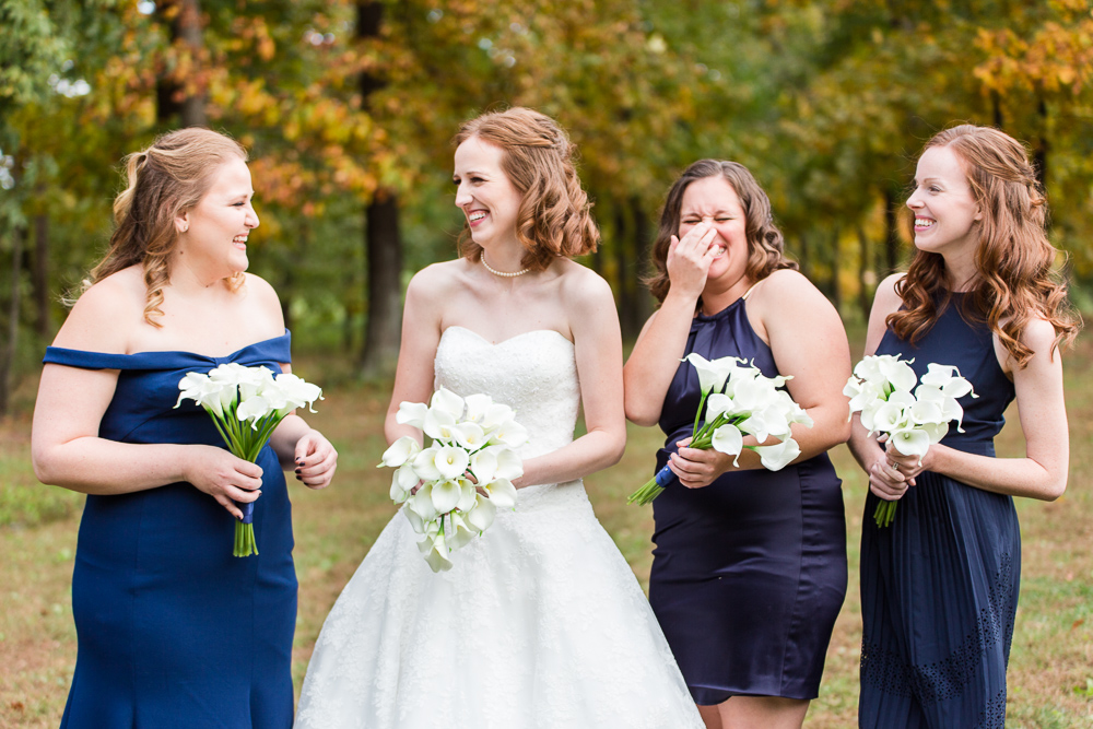 Bride and bridal party in mismatched navy bridesmaid dresses | Leesburg Wedding Photographer
