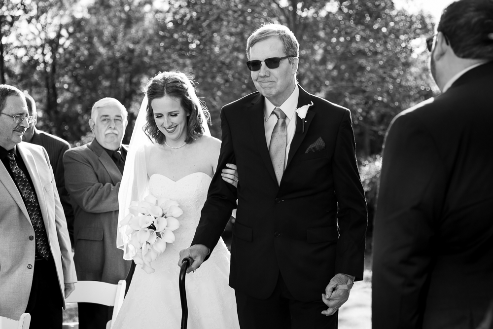Bride and her father walking down the aisle during the wedding ceremony