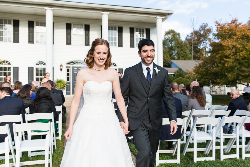 Bride and groom recessional after the wedding ceremony at the Harvest House | Best Leesburg Virginia Wedding Photography