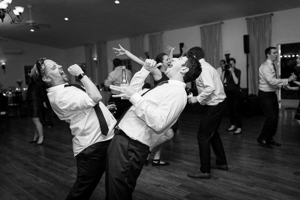 Groomsmen singing on the dance floor | Candid Wedding Photographer in Leesburg, Virginia