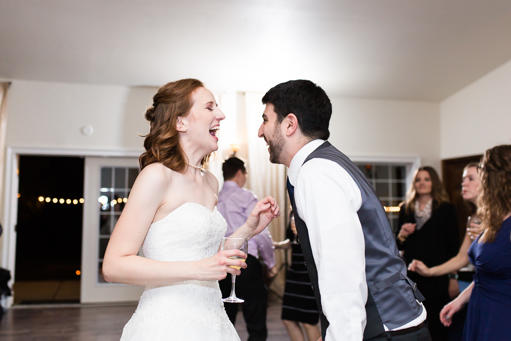 Bride and groom having fun on the dance floor at their wedding at Lost Creek Winery in Loudoun County