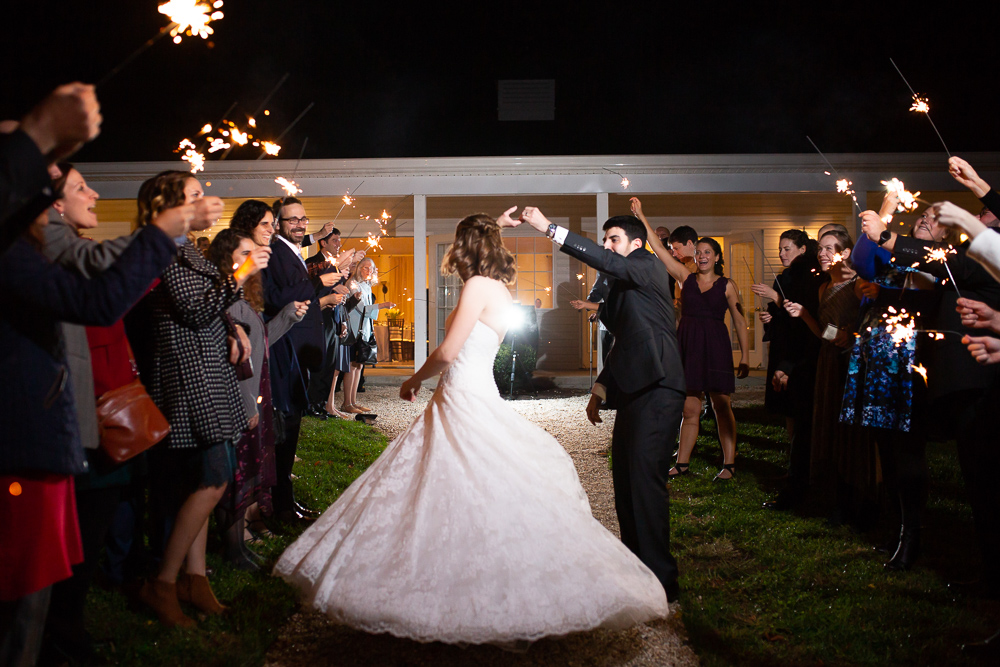 Bride twirling her dress during sparkler exit in Loudoun County