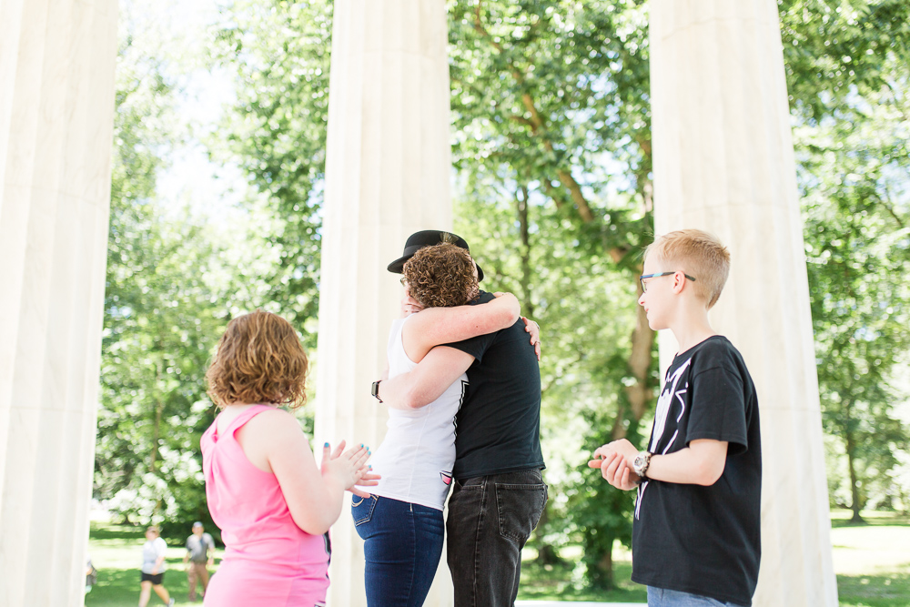 Bride and groom hug while their children look on | DC Elopement Photography