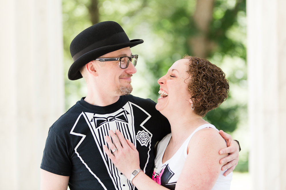 Candid photo of bride and groom laughing in tuxedo t-shirts | Candid DC Wedding Photography