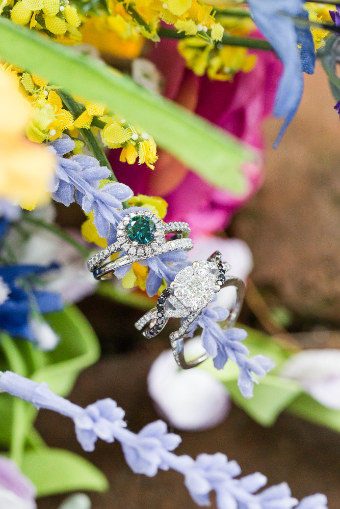 Wedding rings on rainbow bridal bouquets