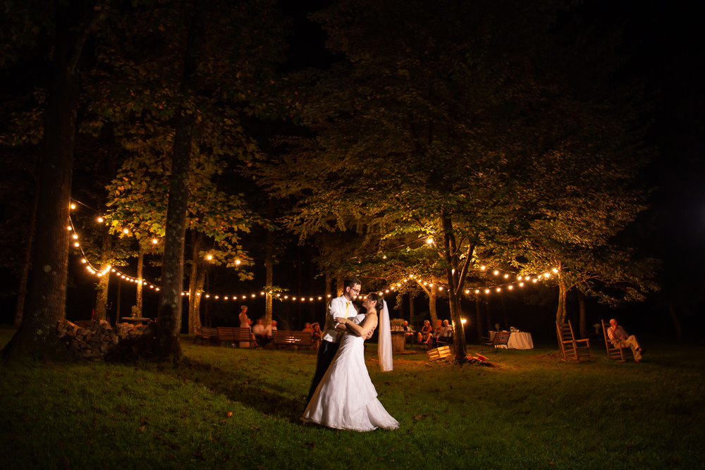 Night wedding photography outside by the fire pit at Lydia Mountain Lodge and Log Cabins