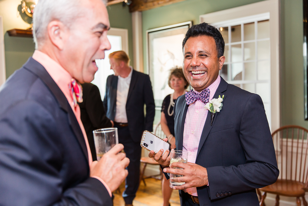 Candid moment of groom laughing with his wedding guests | Fun Northern Virginia Photography