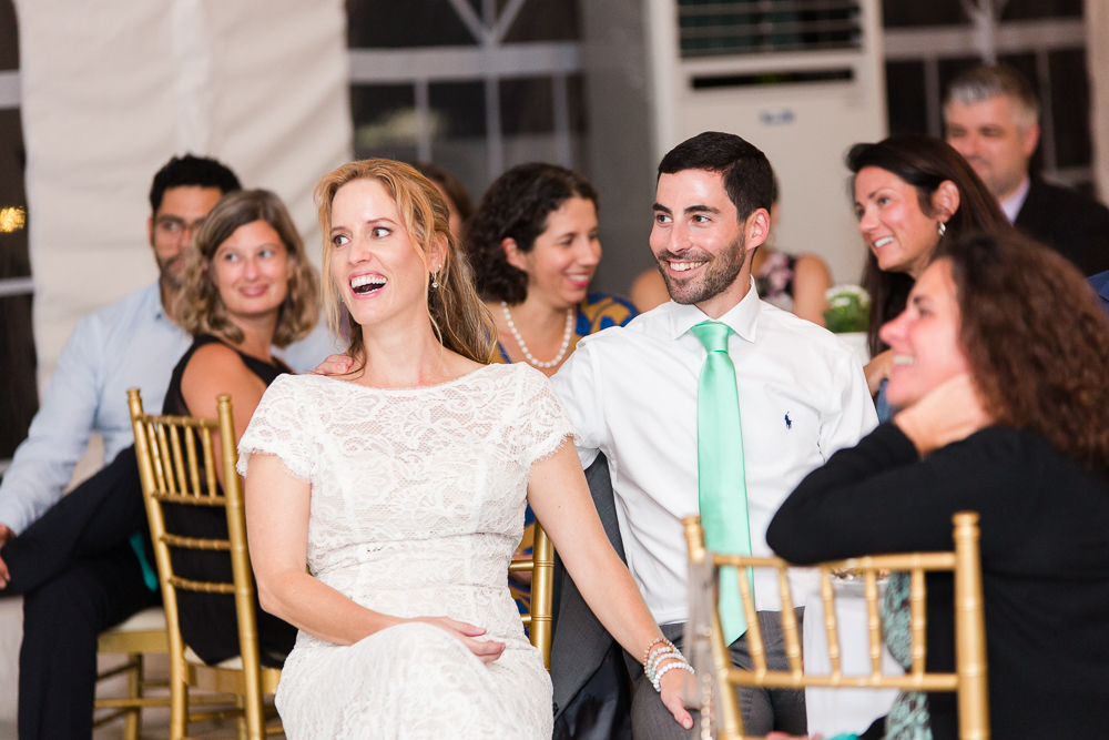 Wedding couple laughing during the toasts in the reception tent at Rust Manor House in Leesburg, VA