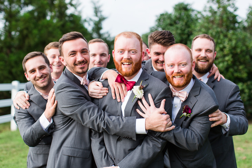 Groom having fun with all his groomsmen during a Richmond, Virginia wedding