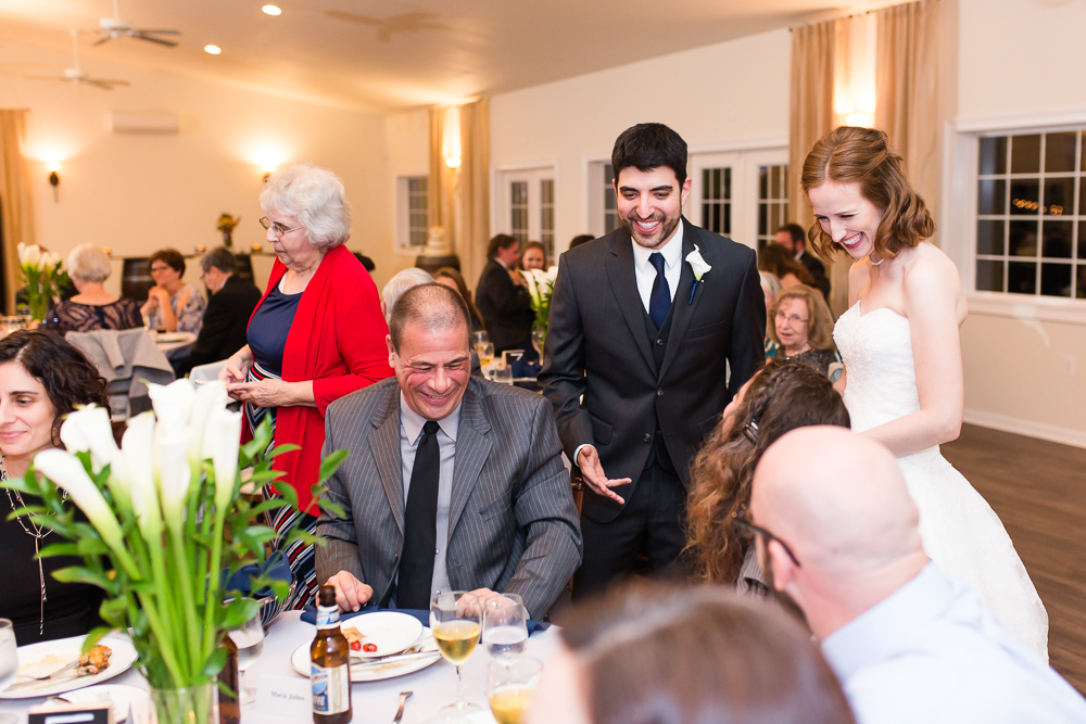 Candid picture of wedding couple mingling with their guests during the reception | Best Candid Northern Virginia Wedding Photography