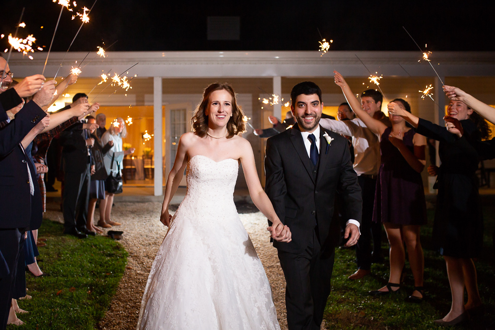 Bride and groom exiting under sparklers after their Leesburg, VA wedding