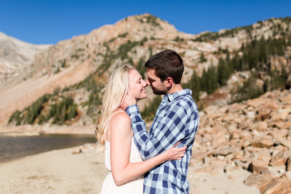 Couple leaning in for a kiss during their mountain engagement shoot