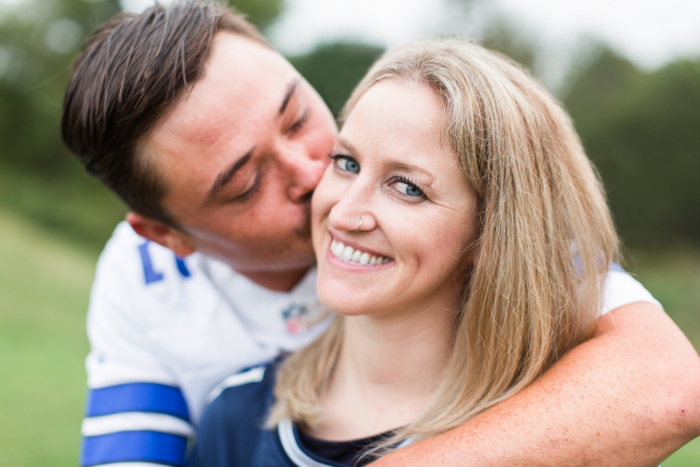 Giving his fiancee a kiss on the cheek during their Fredericksburg, Virginia engagement session