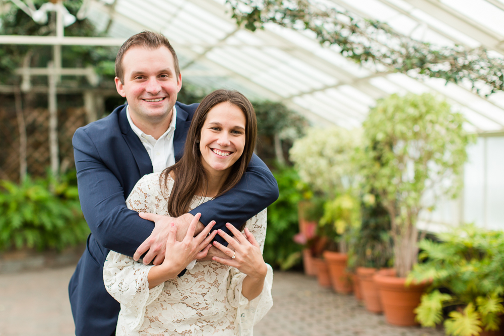 Smiling engaged couple during their botanical garden engagement pictures