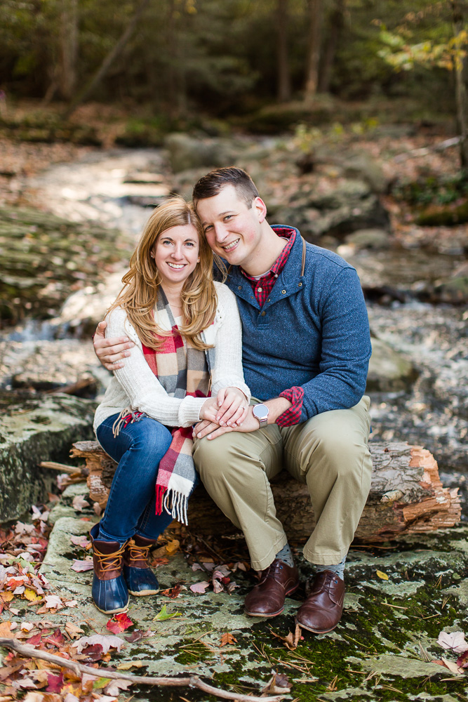 Fall engagement pictures by a creek in the woods | Northern Virginia outdoorsy engagement photographer