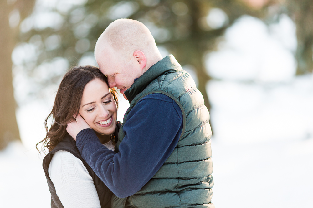 Big smiles during a winter lover's engagement session in Western New York | Outdoorsy engagement photos in Rochester, NY