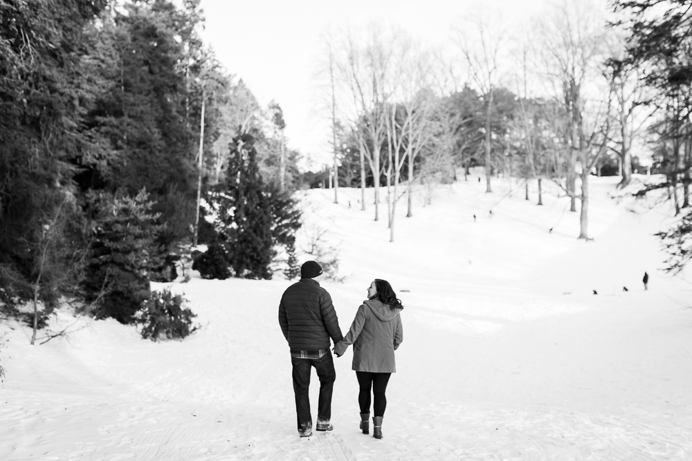Walking hand-in-hand by the sledding hills at Highland Park