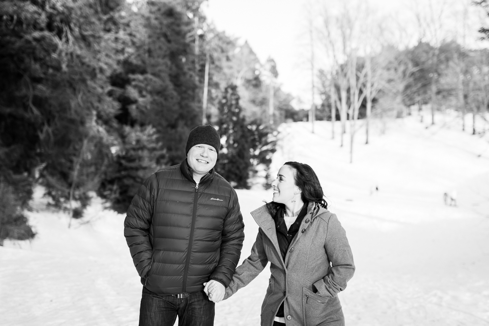 Black and white photo of bride-to-be smiling at her future husband in Highland Park