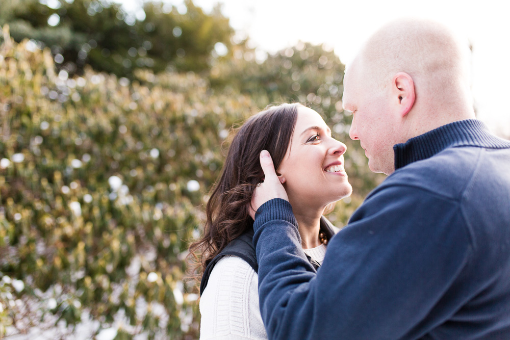 Engaged couple looking into each other's eyes during their winter engagement shoot