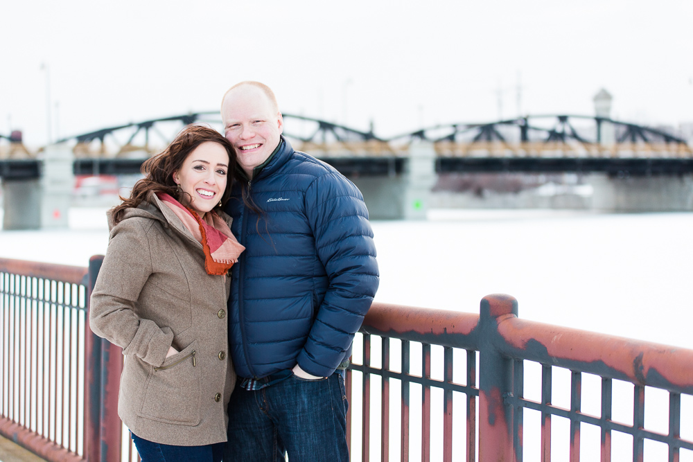 Winter engagement pictures by the Ford Street Bridge in Rochester, NY