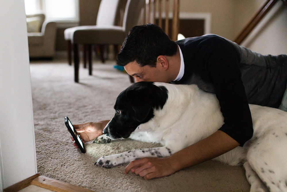Dog scrolling through Instagram with his dad | Lifestyle dog photography in Washington, DC