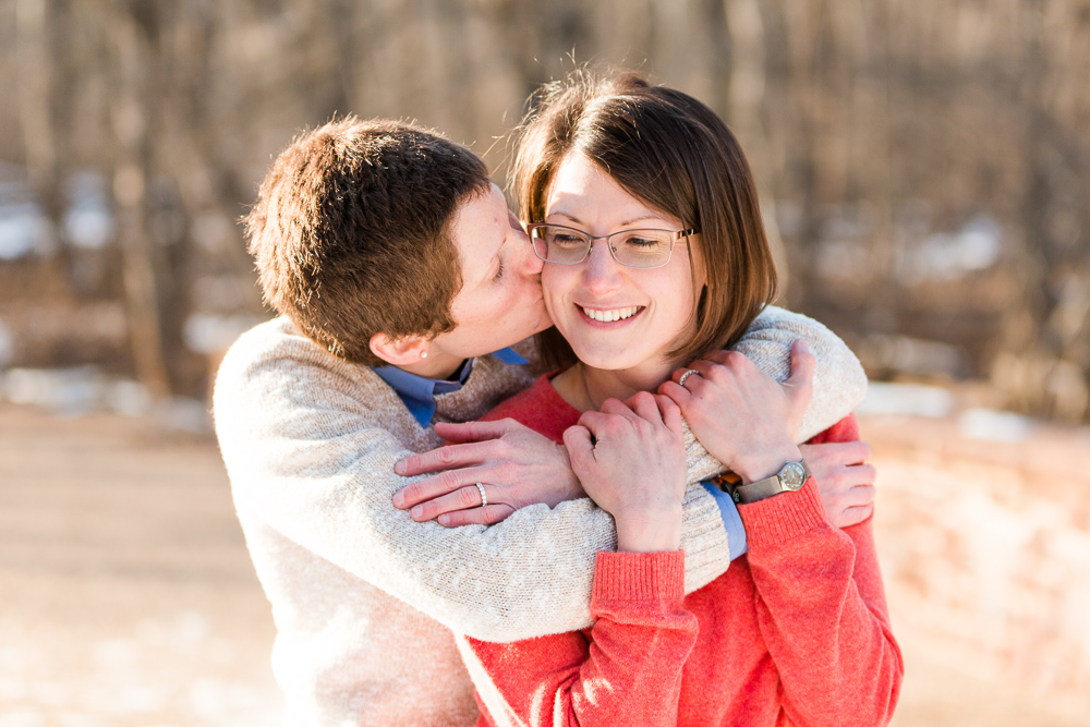Giving her fiancée a kiss on the cheek | DC LGBT engagement photographer