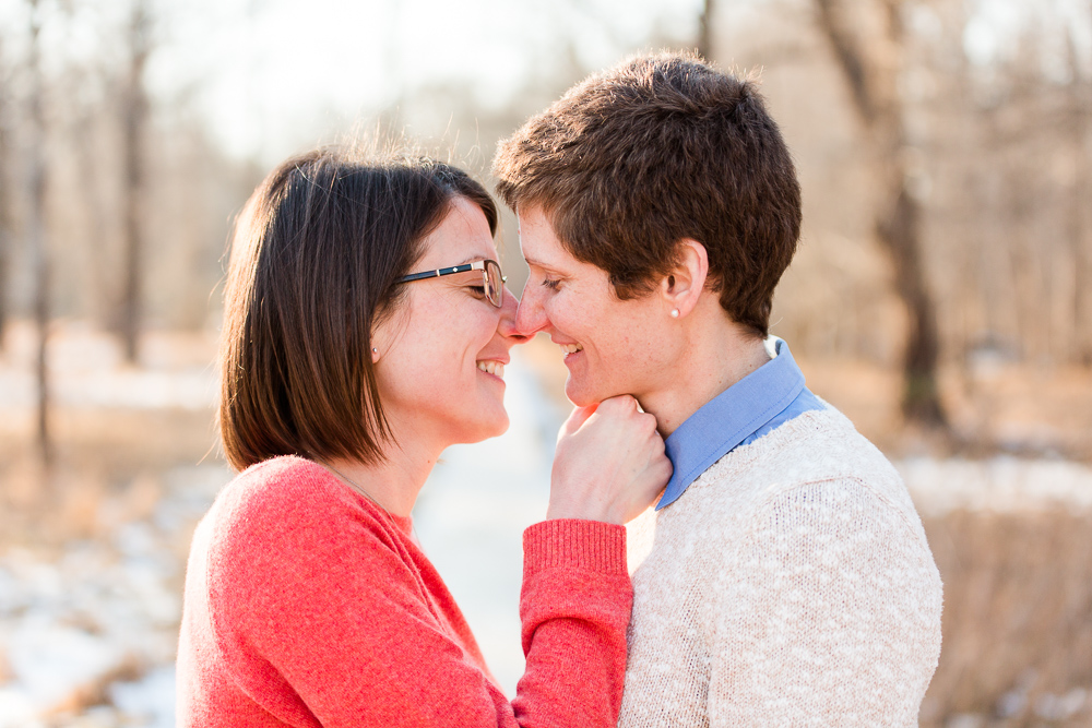 Two brides leaning in for a kiss | Northern Virginia same-sex engagement photographer