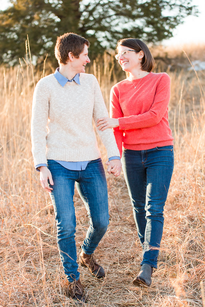 Candid engagement picture of same-sex couple walking through the battlefield | Candid Northern Virginia photographer