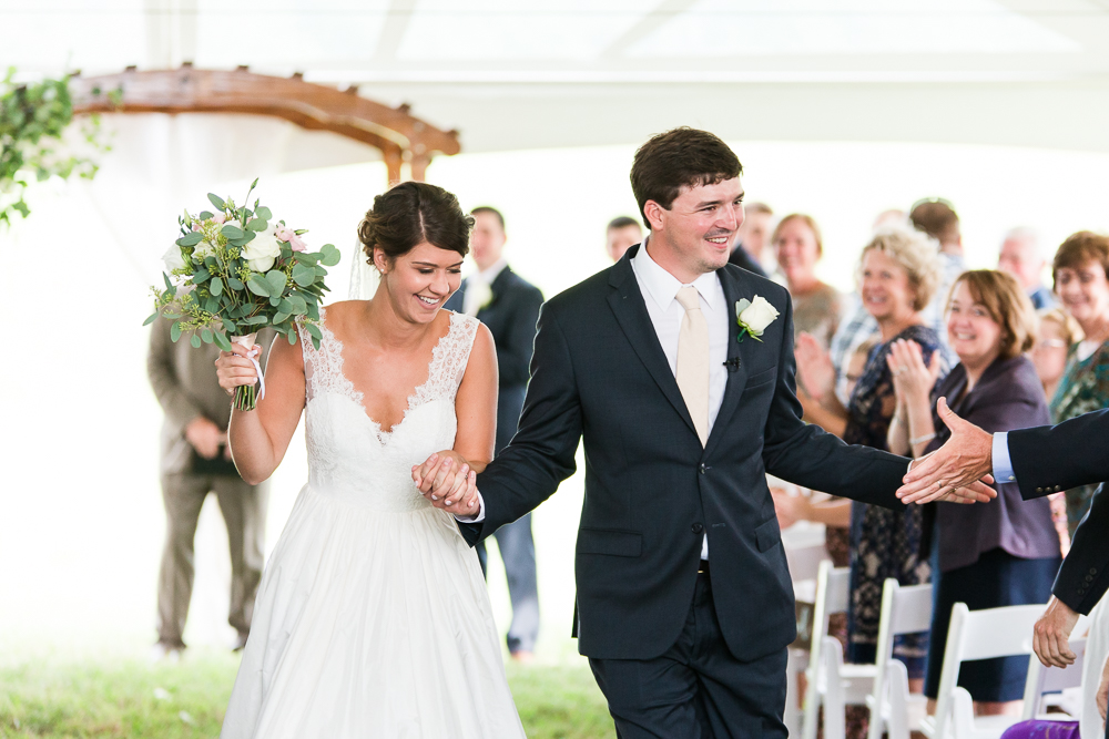 Wedding rain plan with a backup ceremony location under a big white tent | How to prepare for rain on your wedding day