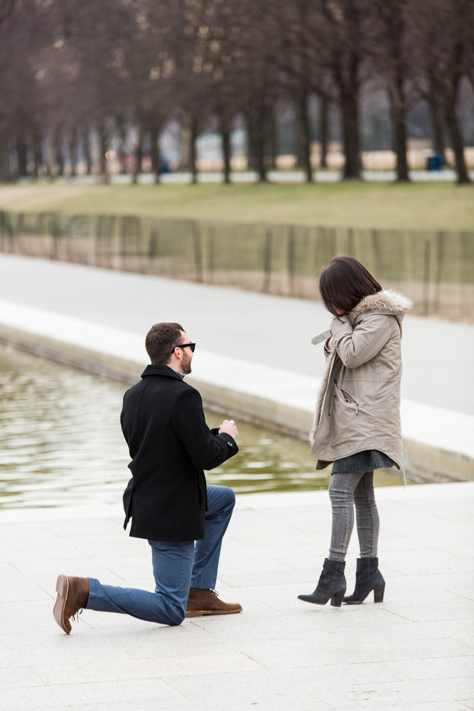 Surprised as her boyfriend kneels down to pop the question | Proposal photographer in Washington, DC