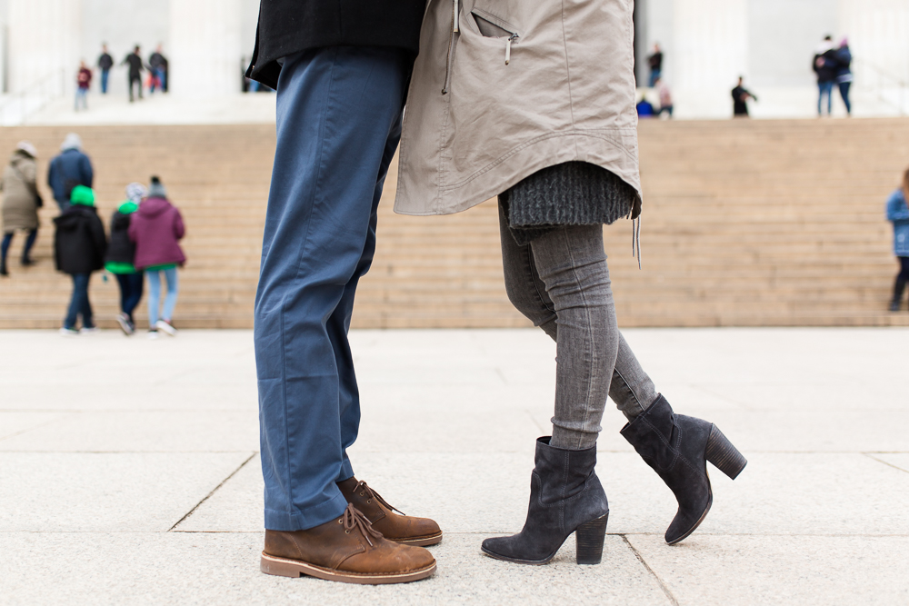 Close up engagement photo of couples shoes in front of the Lincoln Memorial steps