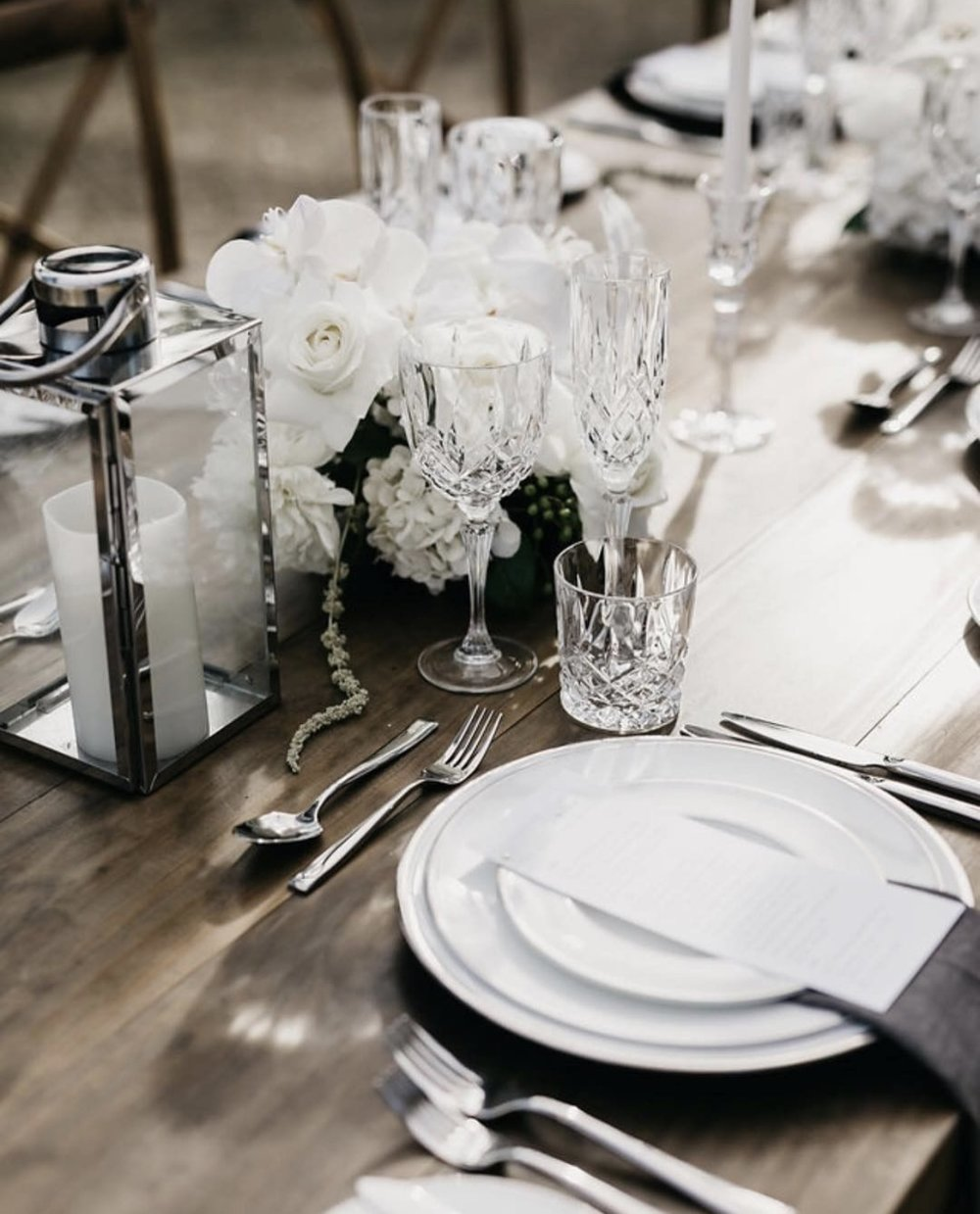 Waterford Crystal Glassware + Limoges platinum charger plate + Waterford dinnerware + Charcoal French Linen Napkins - Photography by Cassandra Ladru