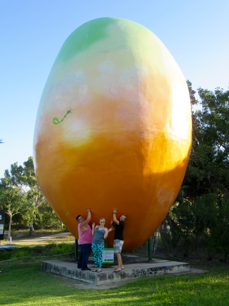 Jacob, Patricia and Matthew holding up the giant mango.